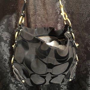 Coach Carly signature handbag 1069
